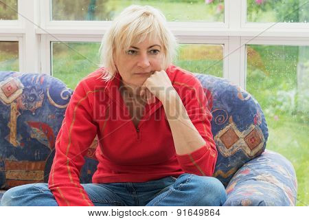 Thoughtful Blonde Middle Aged Woman