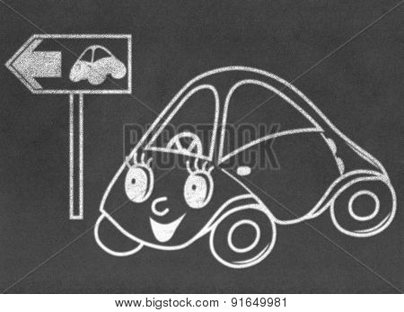 Toy car on green way on chalkboard
