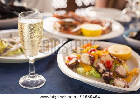 Italian Cuisine. Glass Of Prosecco And Variety Of Seafood