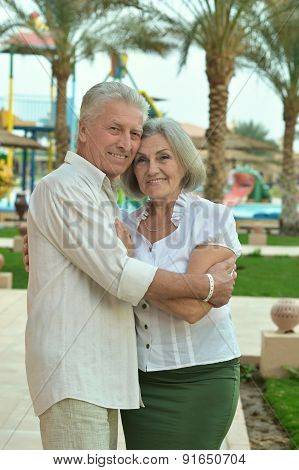 Senior couple at tropic hotel garden