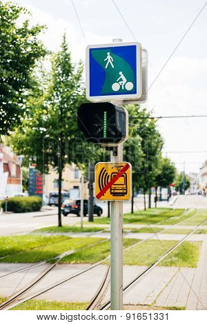Tramway Semaphore With Instruction To Bikers In Green City Urban Area