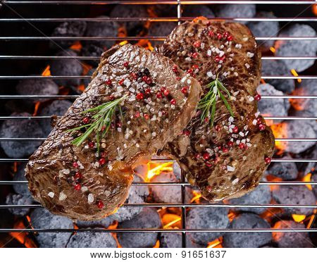 Beef steaks roasted on grill