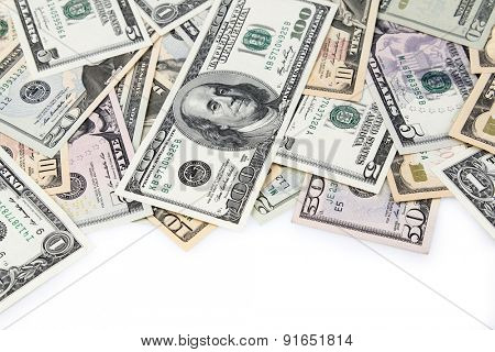 Closeup of assorted American banknotes on plain background