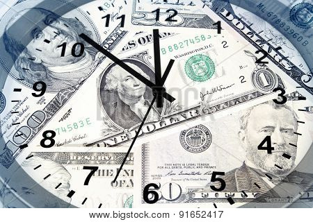 Clock face and American banknotes