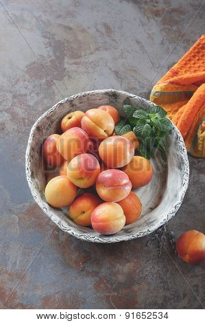 Apricots in ceramic bowl