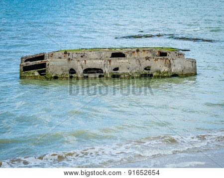 Ruins of Allied Mulberry port in Arromanches, Normandy