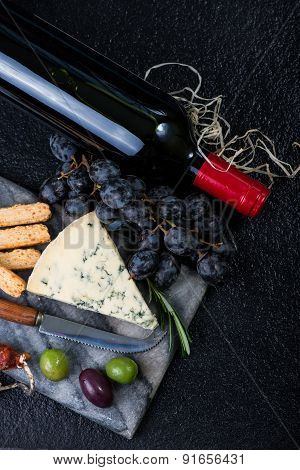 Marble Board With Cheese Selection, Wine And Grapes