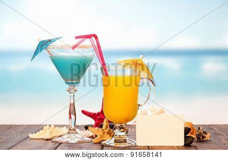 Cocktail with umbrella and juice