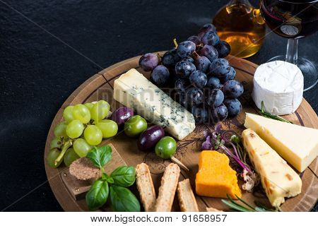Cheese Board With Fresh Grapes,herbs And Olives