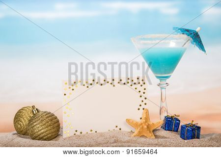 Christmas cocktail with umbrella and starfish