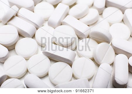 Pile of white pills, closeup