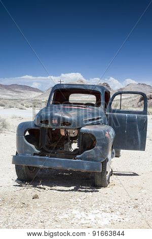 Rusty Old Truck In Ghost City Rhyolite In In Goldwell Open Air Museum In Nevada, United States
