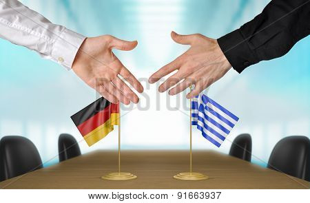 Germany and Greece diplomats agreeing on a deal