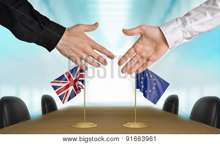 United Kingdom and European Union diplomats agreeing on a deal