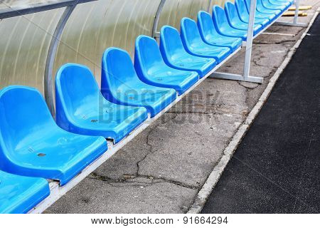 Empty blue seats in stadium