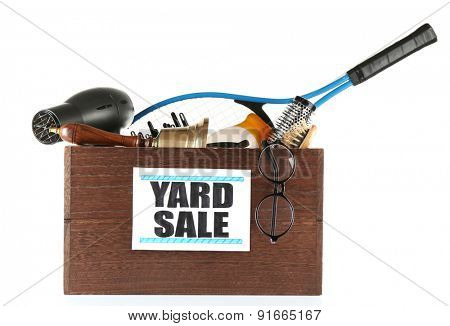 Box of unwanted stuff ready for yard sale isolated on white