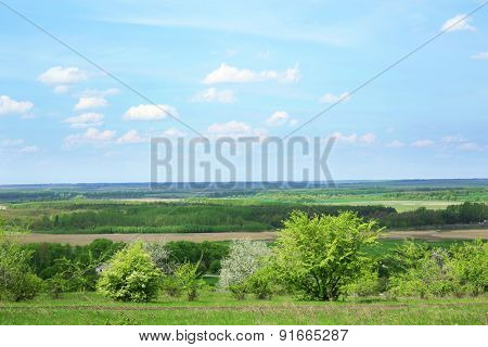Beautiful view of countryside over blue sky background