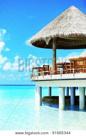Restaurant over blue ocean in Baros Maldives