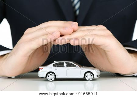 Man holding model of car in his hands, closeup