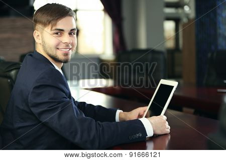 Businessman working with tablet in office