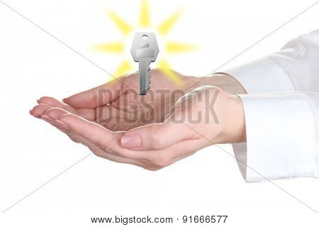 Female hands with key isolated on white