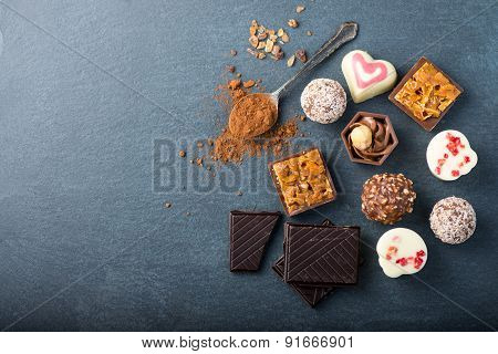 Selection Of Artisan Chocolates Praline On Black Background