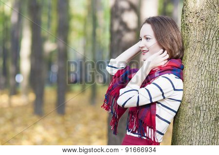 Style And Fashion Concept: Caucasian Female Model Dressed In Stylish Clothing. Standing Outdoors In