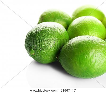 Group of fresh limes isolated on white
