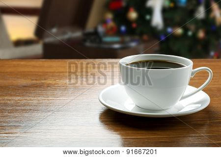 Cup of coffee on table in coffee shop