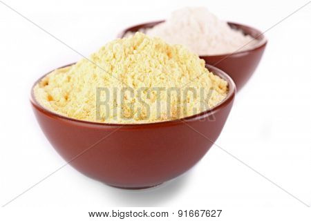 Flour in bowls isolated on white