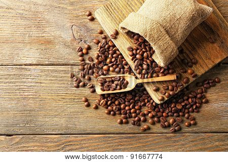 Coffee beans on wooden background