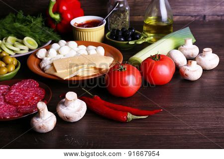 Different products on wooden table close up