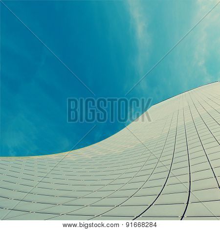 Abstract facade of modern high commercial building. Toned photo