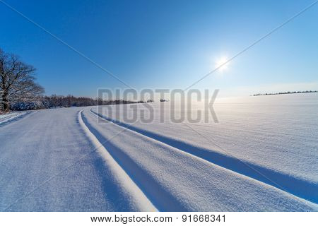 Sunrise on winter landscape. snow field