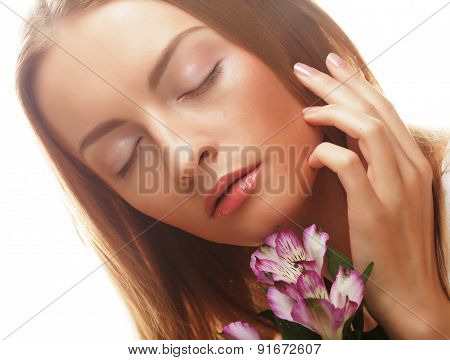 young happy woman with pink flowers