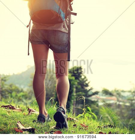 woman hiker at mountain peak