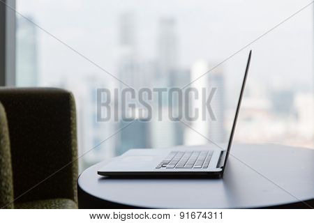 technology, business and modern life concept- close up of open laptop computer on table at office or hotel room