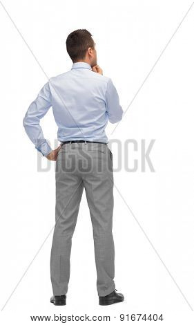 business, people, dilemma, rear view and office concept - businessman thinking from back