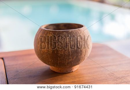 objects concept - empty bowl on table at hotel spa or swimming pool