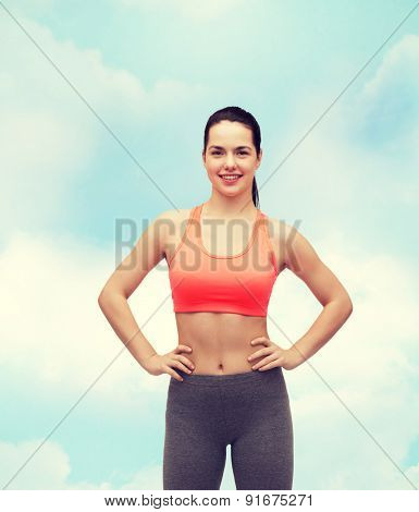 fitness and diet concept - smiling teenage girl in sportswear