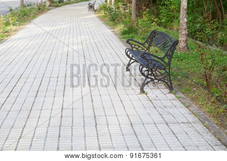 Iron bench situated on a lonely walk