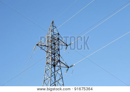 Metal pylon with a blue sky background