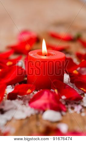 Roses with pile of salt ,candle  on old wooden board