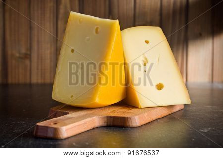block of edam cheese on kitchen table