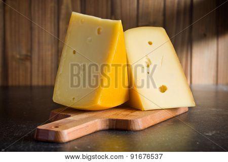 block of edam cheese on kitchen table