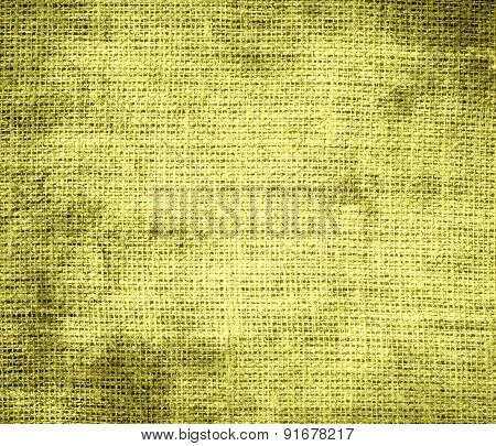 Grunge background of citrine burlap texture