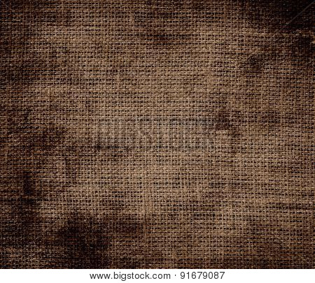 Grunge background of coffee burlap texture