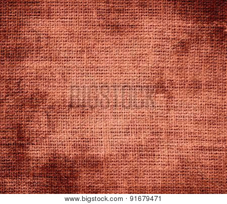Grunge background of copper red burlap texture