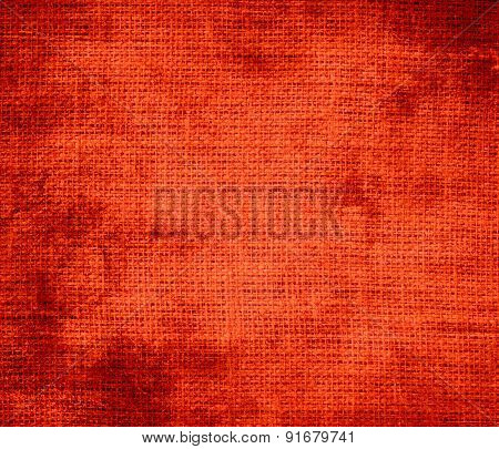 Grunge background of coquelicot burlap texture