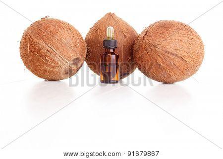 bottle of coconut essential oil - beauty treatment